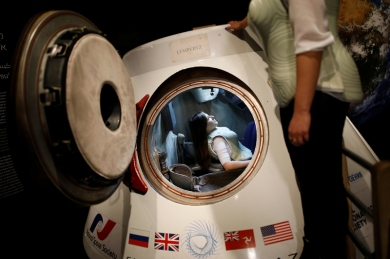 A woman wearing a prototype of Stemrad's new protective vest, Astrorad, sits inside Russian spacecraft, Excalibur-Almaz Space Capsule, during a demonstration for Reuters, at Madatech, National Museum of Science Technology and Space in Haifa, Israel February 23, 2017. Photo: Reuters